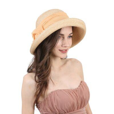 Шляпа соломенная декорированная лентой